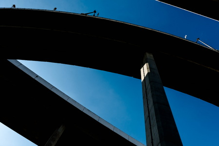 Silhouette of highway ramps on a sunny day, useful for construction, engineering, transportation, building, industrial concepts Stock Photo