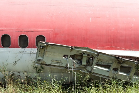 Plane fuselage wreckage sitting on the ground, taken on a sunny day, useful for plane safety, pilot, flights, air craft, aero space industry, travel, holiday, insurance related concepts