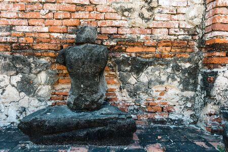 Broken buddha statue, taken outdooor in afternoon, useful for religious and faith concepts