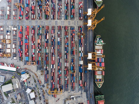 Aerial topdown shot of large bangkok shipping port taken in afternoon, useful for commercial shipping industry concepts