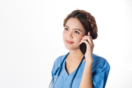 surgent: Asian female medical nurse using smart phone on white background, useful for medical, hospital, medication, surgent, medical advise, doctor, health care concepts