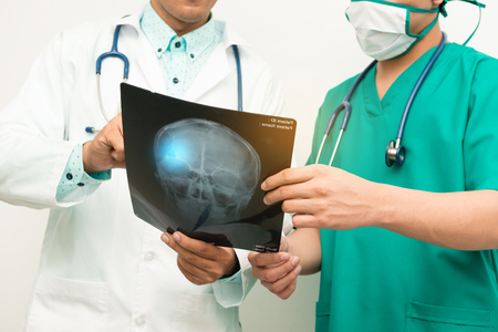 surgent: Asian male medical doctors with xray film on white background, useful for medical, hospital, medication, surgent, medical advise, doctor, health care concepts