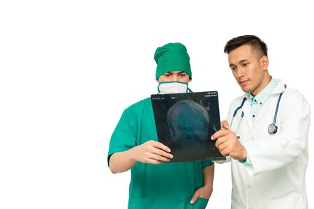 diagnose: Asian male medical doctors with xray film on white background, useful for medical, hospital, medication, surgent, medical advise, doctor, health care concepts