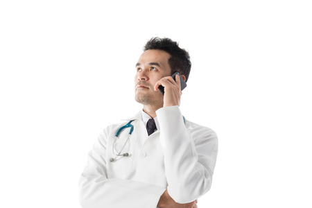 surgent: Asian male medical doctor using smart phone on white background, useful for medical, hospital, medication, surgent, medical advise, doctor, health care concepts