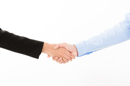 Young talent handshake between blue shirt business man and business woman suit on white background. Asian, Chinese, Japanese, Korean, young confident business sale deal communication design concept 写真素材