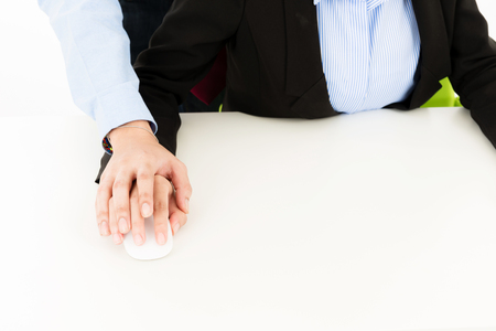 Young confident Asian office employee business man red tie touch attractive Asian woman on hand. For office sexual harassment offender abuse behavior in office cooperate communication design Stock Photo