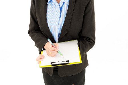 Young attractive confident asian woman, orange safety hat, glass, black suit, blue shirt on white background writing on notepad. For engineering, construction, architecture, business man concepts.