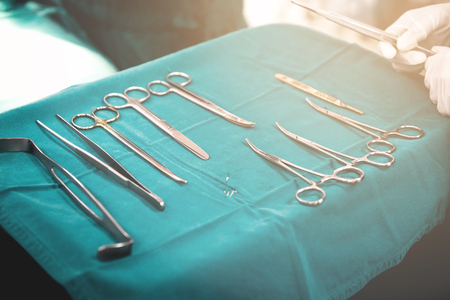 Surgery tools. Multiple surgery tools on a plate in operating room. Advance medical concept.