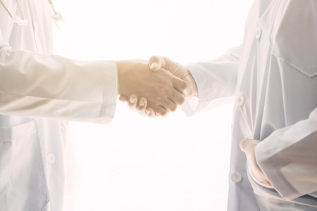 Successful doctor shake hands. Chinese doctors. Male and female doctors. Successful medical treatment concept. Stock fotó