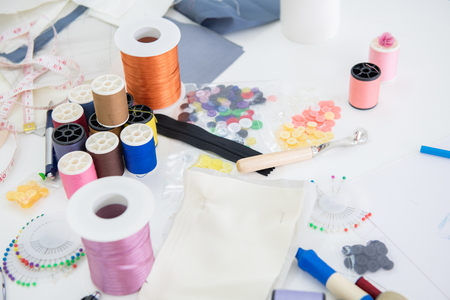 Fashion design background. Many design and sewing equipments laying on table. For fashion design background concept. Stock fotó
