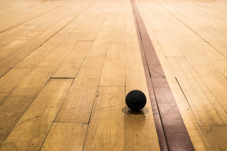 Squash ball on wood floor