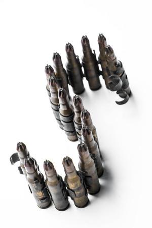 m16 ammo: Bullets arrange in S alphabet on white background Stock Photo