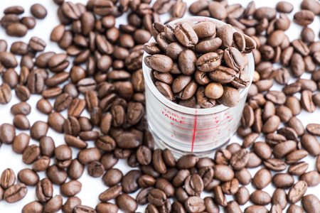 shot glass: Roasted coffee beans in coffee shot glass Stock Photo