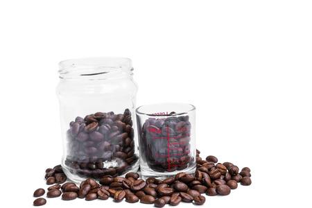 shot glass: roasted coffee beans, coffee shot glass and glass jar Stock Photo