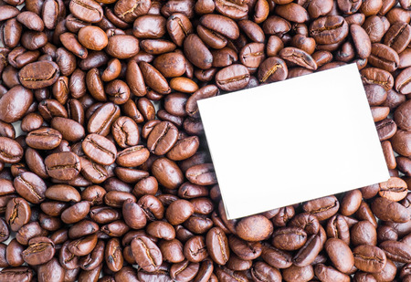 work addicted: Blank paper note on roasted coffee beans Stock Photo
