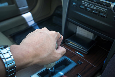 shifting: Hand of driver shifting gear of automatic car