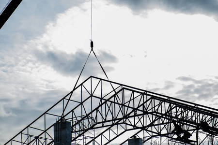 metal structure: Silhouette under construction of roofs steel frame