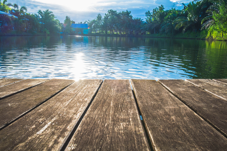 board desk: antique wooden pier on the lake with sunlight effects Stock Photo