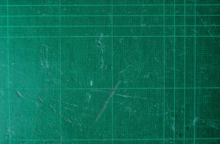 grid background: old used scratch cutting mat texture