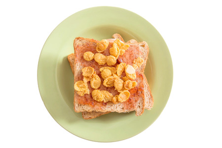 plato del buen comer: Toasted bread fill with strawberry jam and sweet cornflakes, isolated on white background