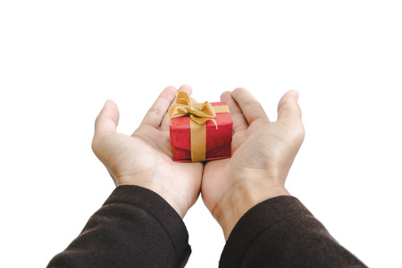 close-up hand holding, giving or receiving gift box, isolated on white background Stock Photo