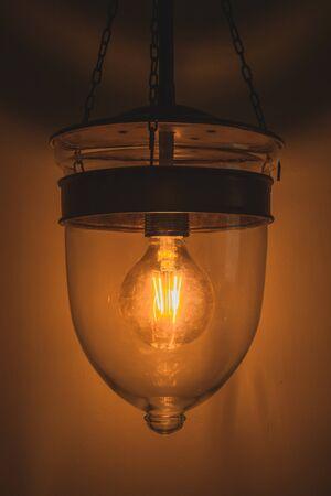 dim light: Vintage tone, old retro Edison light bulb with dim light Stock Photo