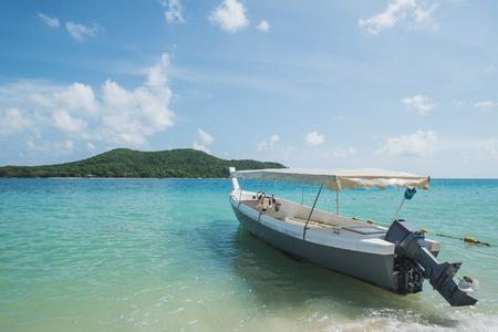 speedboat: Traveler speedboat parked on the beach at island in Thailand