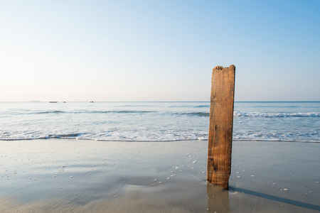beach paradise: Wood plate stick in sand on the beach