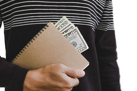 man holding book: A man holding book with cash hiding inside, isolated on white background