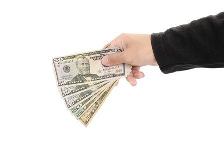 efectivo: Mano que sostiene el dinero en efectivo, aislado en fondo blanco Foto de archivo