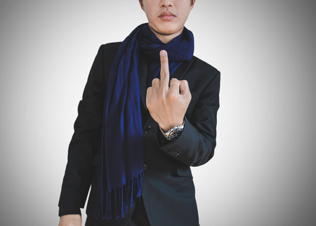 indignant: Businessman in casual suit showing middle finger Stock Photo