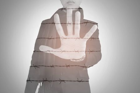 bare wire: Double exposure, businessman show palm with barbed wire, abstract concept
