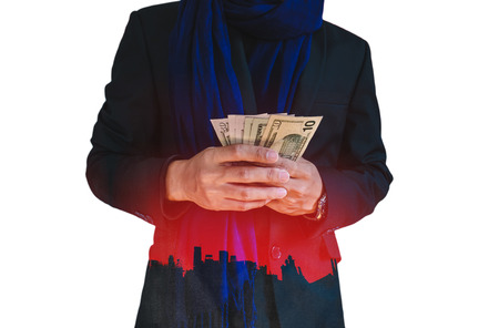 corruptible: Businessman holding cash with silhouette city background, abstract concept, isolated on white background
