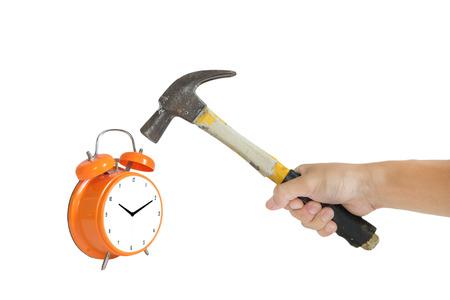 smashing: a man hand holding old hammer smashing alarm clock, isolated on white background Stock Photo