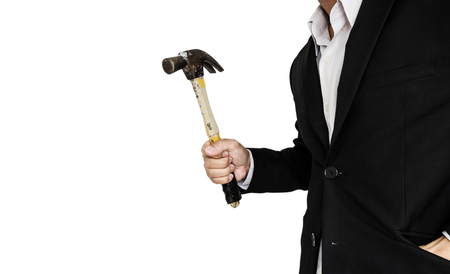 body built: Businessman holding old hammer, isolated on white background
