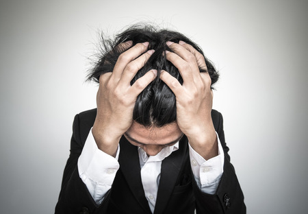 Close-up businessman with burnout syndrome