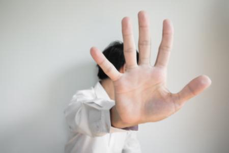 de focused: Blurred de focused, a man showing palm hand, concept of denial Stock Photo