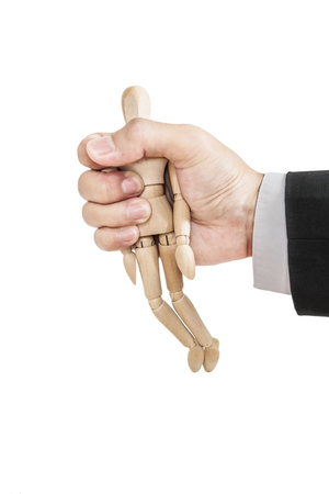 grasp: Businessman holding wooden figure, abstract concept, isolated on white background Stock Photo