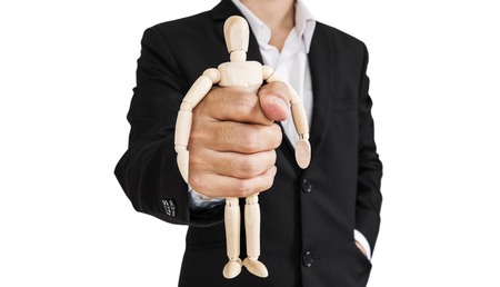 impotent: Businessman holding wooden figure, abstract concept, isolated on white background Stock Photo