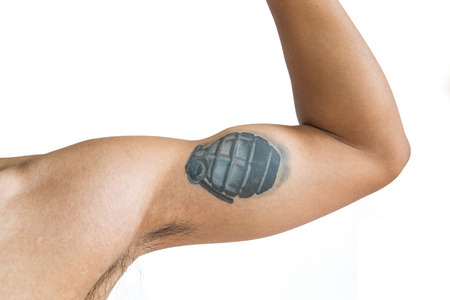 male arm: Tan skin arm with portrait grenade tattoo, isolated on white background Stock Photo