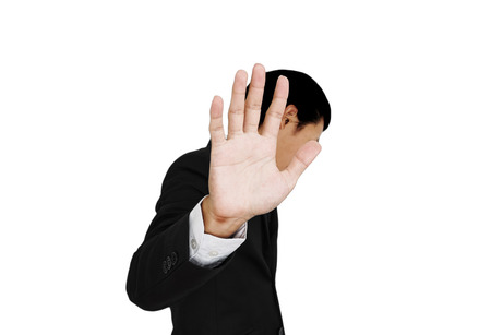 insulted: Businessman showing palm hand, denial concept, isolated on white background