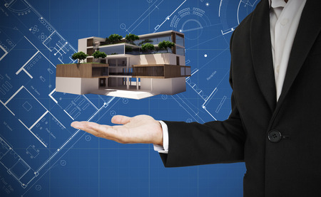 house  houses: Businessman in presenting position with modern architecture on hand, and blueprint background