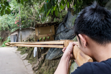crossbow: a guy aim crossbow to the target