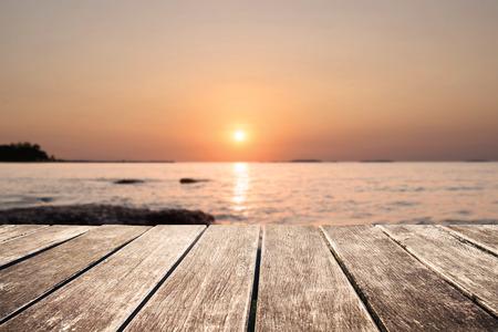 de focus: Wooden pier with de focus sunset view on the island