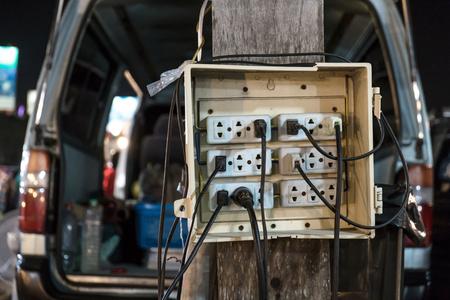 plug socket: Old public plug socket at outdoor night market