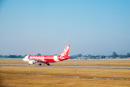 december 21: SATTAHIP, THAILAND - 21 DEC - Air Asia airlines passenger plane at U-Tapao airport with dried grass ground at Sattahip, Thailand on December 21, 2015