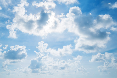 behind scenes: Blue sky and clouds with sun behind clous Stock Photo