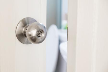 doorlock: Close-up door knob with door opening slightly