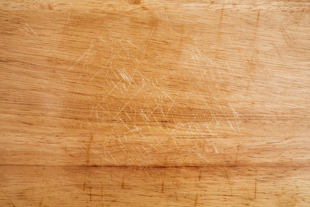 trencher: Old scratched wooden cutting board texture Stock Photo