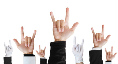 analogy: Heavy metal hand sign of difference career raising upward, isolated on white background